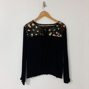 Black shirt with floral embroidery